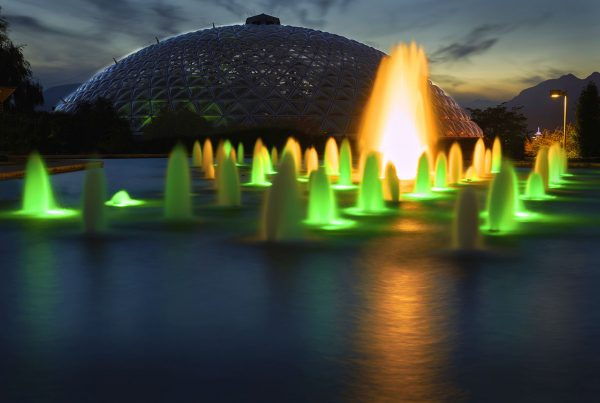 The illuminated fountain in Queen Elizabeth Park at night. Vancouver, British Columbia, Canada.